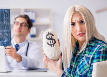 Photo for Concept of expensive healthcare with woman visiting male doctor - Royalty Free Image