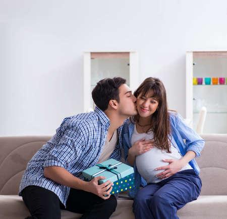 Photo pour Happy family celebrating pregnancy at home - image libre de droit