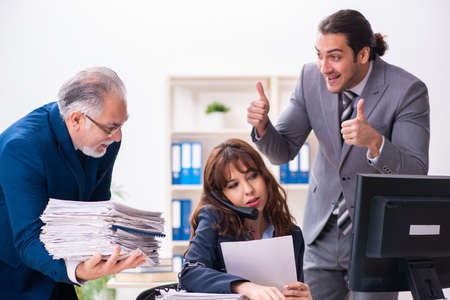 Photo pour Two male and one female employees working in the office - image libre de droit