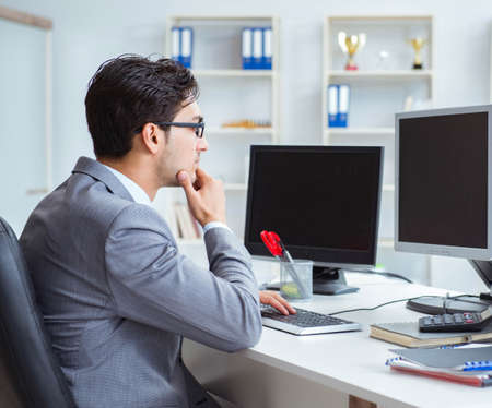 Photo pour Businessman sitting in front of many screens - image libre de droit