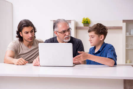 Photo pour Grandfather learning new technology from son and grandson - image libre de droit