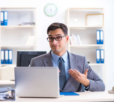 Photo for Handsome businessman employee sitting at his desk in office - Royalty Free Image