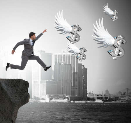 Photo for The businessman chasing angel dollars in business concept - Royalty Free Image