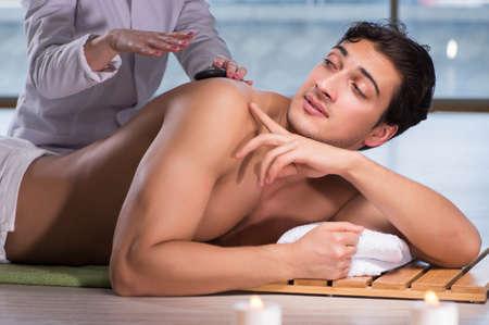 Photo pour Young handsome man during spa procedure - image libre de droit