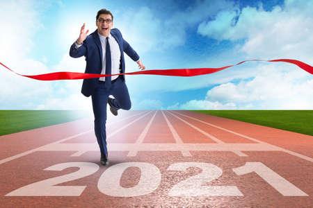 Photo pour Businessman on finish line to year 2021 - image libre de droit