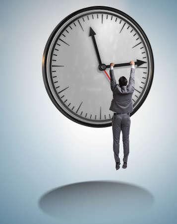 Photo pour Businessman in time management concept - image libre de droit