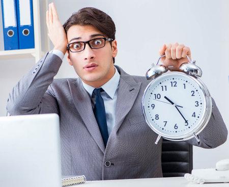 Photo pour Businessman employee in urgency and deadline concept with alarm - image libre de droit