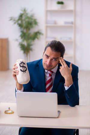 Photo pour Young businessman employee in remuneration concept - image libre de droit