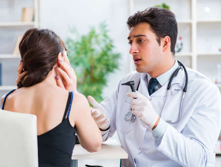 Photo pour Doctor checking patients ear during medical examination - image libre de droit