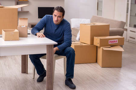 Photo for Young man moving to new flat - Royalty Free Image
