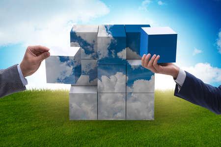 Photo pour Businessman building cloud cube with shapes - image libre de droit