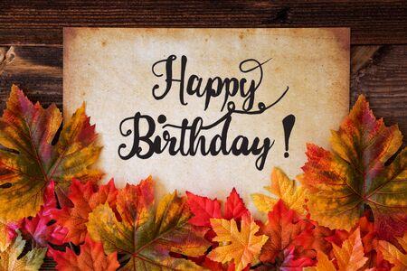 Photo pour Old Paper With Text Happy Birthday, Colorful Leaves Decoration - image libre de droit
