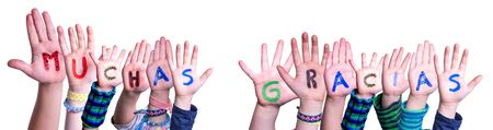 Photo for Children Hands Building Word Muchas Gracias Means Thank You, Isolated Background - Royalty Free Image