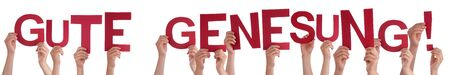 Photo pour People Hands Holding Word Gute Genesung Means Get Well Soon, Isolated Background - image libre de droit