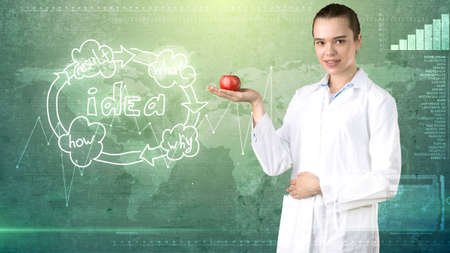 Beautiful medical woman doctor in uniform. Studio painted background. Concept of profitable health care.