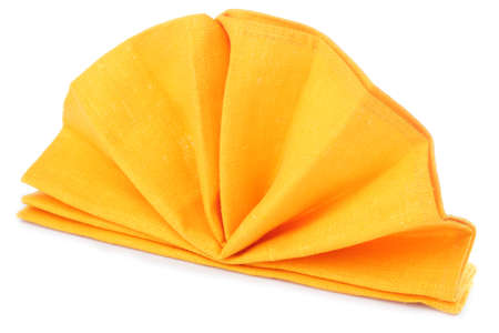 Napkin folded as a standing fan isolated on white background