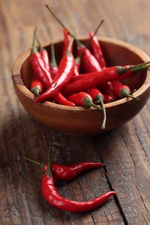 Red chili peppers in a wooden bowl
