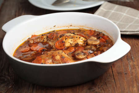 Hunters rabbit stew with carrot in a pan