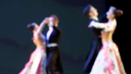 Defocused image of people dancing the waltz