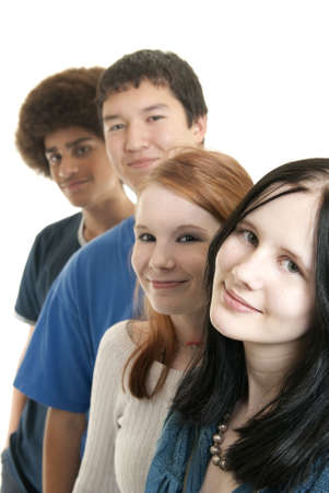 Four teens of different ethnic backgrounds smiling