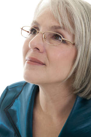 Foto für Mature, attractive Caucasian woman looking off into the distance. - Lizenzfreies Bild