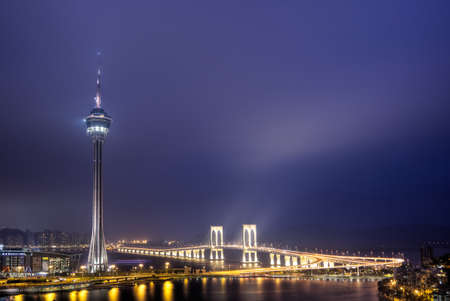Macao landmark, travel tower in night, cityscape in Macau, China.