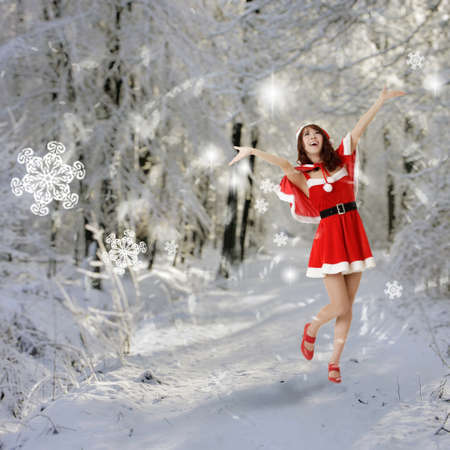 Happy Christmas woman open arms in snow forest.