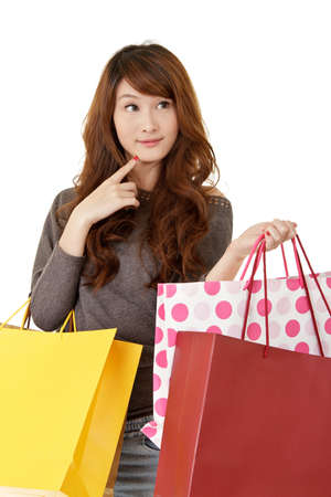 Attractive young shopping woman thinking, closeup portrait on white background.