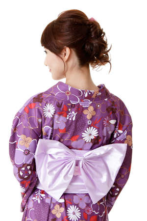 Japanese elegant woman in traditional clothes, kimono, closeup portrait of back view.