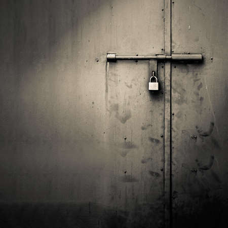Photo pour Background of door with lock in metal material and copyspace on wall. - image libre de droit