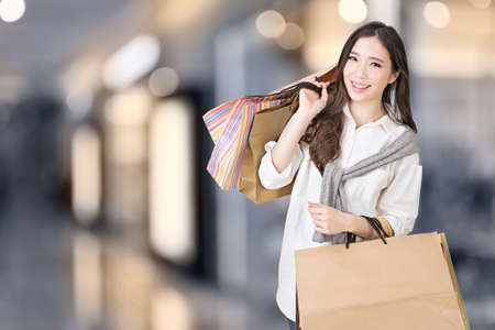 Photo for Asian woman shopping, closeup portrait in the mall. - Royalty Free Image