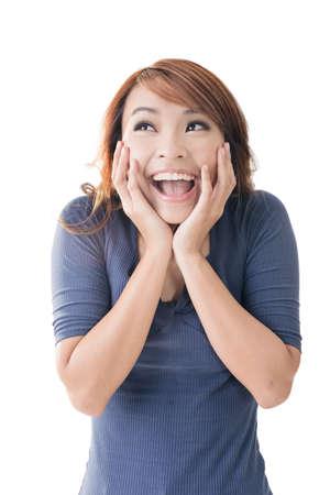 Photo pour Excited happy Asian girl face, closeup portrait. - image libre de droit