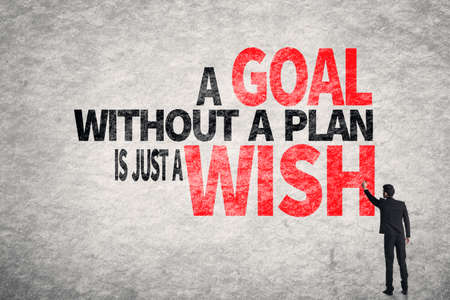 Asian business man write words on wall, A Goal without a Plan is Just a Wish