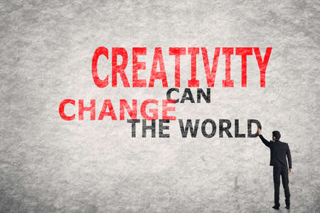 Photo for Asian businessman write text on wall, Creativity Can Change The World - Royalty Free Image