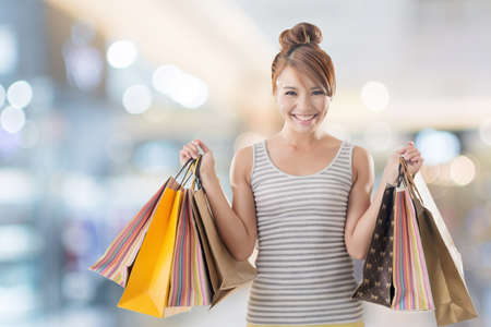 Foto de Shopping girl of Asian, closeup portrait isolated on white with clipping path. - Imagen libre de derechos