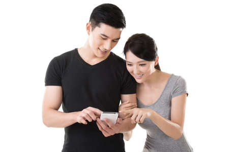 Foto de Asian young couple using cellphone, closeup portrait. - Imagen libre de derechos
