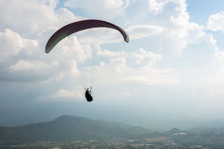 Photo for colorful paragliding over blue sky with white clouds in the town, Puli, Taiwan - Royalty Free Image
