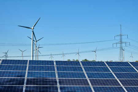 Photo pour Solar panels, wind turbines and overhead power lines lakes in Germany - image libre de droit