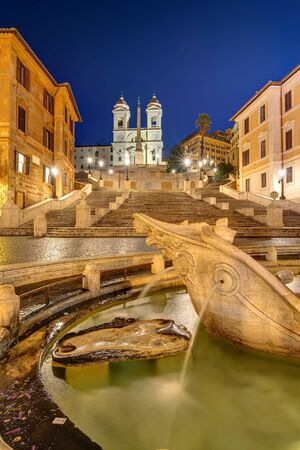 Photo for The famous Spanish Steps with a fountain in Rome at night - Royalty Free Image