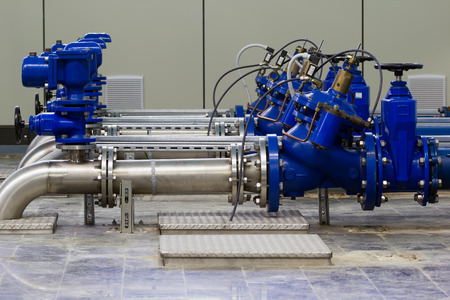 Photo pour Water pumping station with booster pumps and valves. - image libre de droit