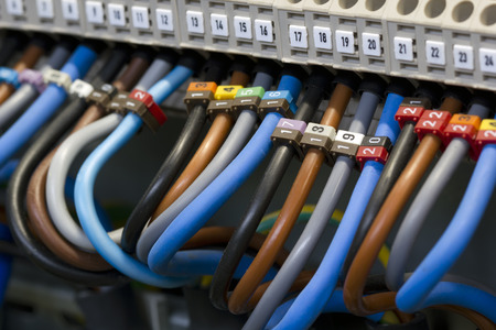 Close up of a three phase power supply electrical wiring and terminals.