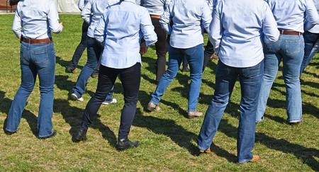 Photo pour Western line dancers outdoor - image libre de droit