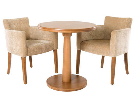 Wooden table and armchairs on white
