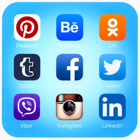 Simferopol, Russia - April 21, 2015: Icons of most popular social networking applications printed on paper.