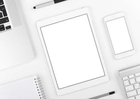 Photo for Top view: Laptop tablet and smartphone on white table background with text space and copy space. - Royalty Free Image