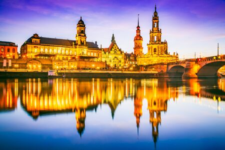 Dresden, Germany. Cathedral of the Holy Trinity or Hofkirche, Bruehl's Terrace. Twilight sunset on Elbe river in Saxony.