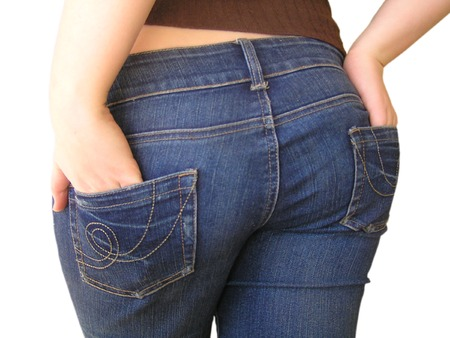 A cheeky shot of the behind of a girl in jeans. Isolated on a white background.