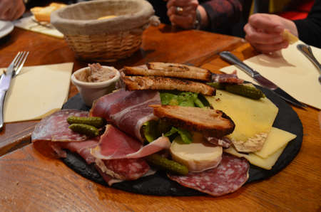 A charcuterie plate in a Paris Cafe enjoyed between friends