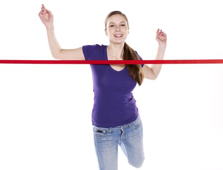 young woman crossing finishing line
