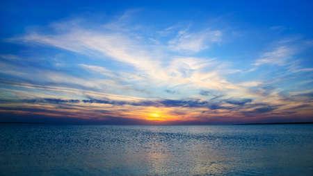 Bright paniramic sunset under the sea